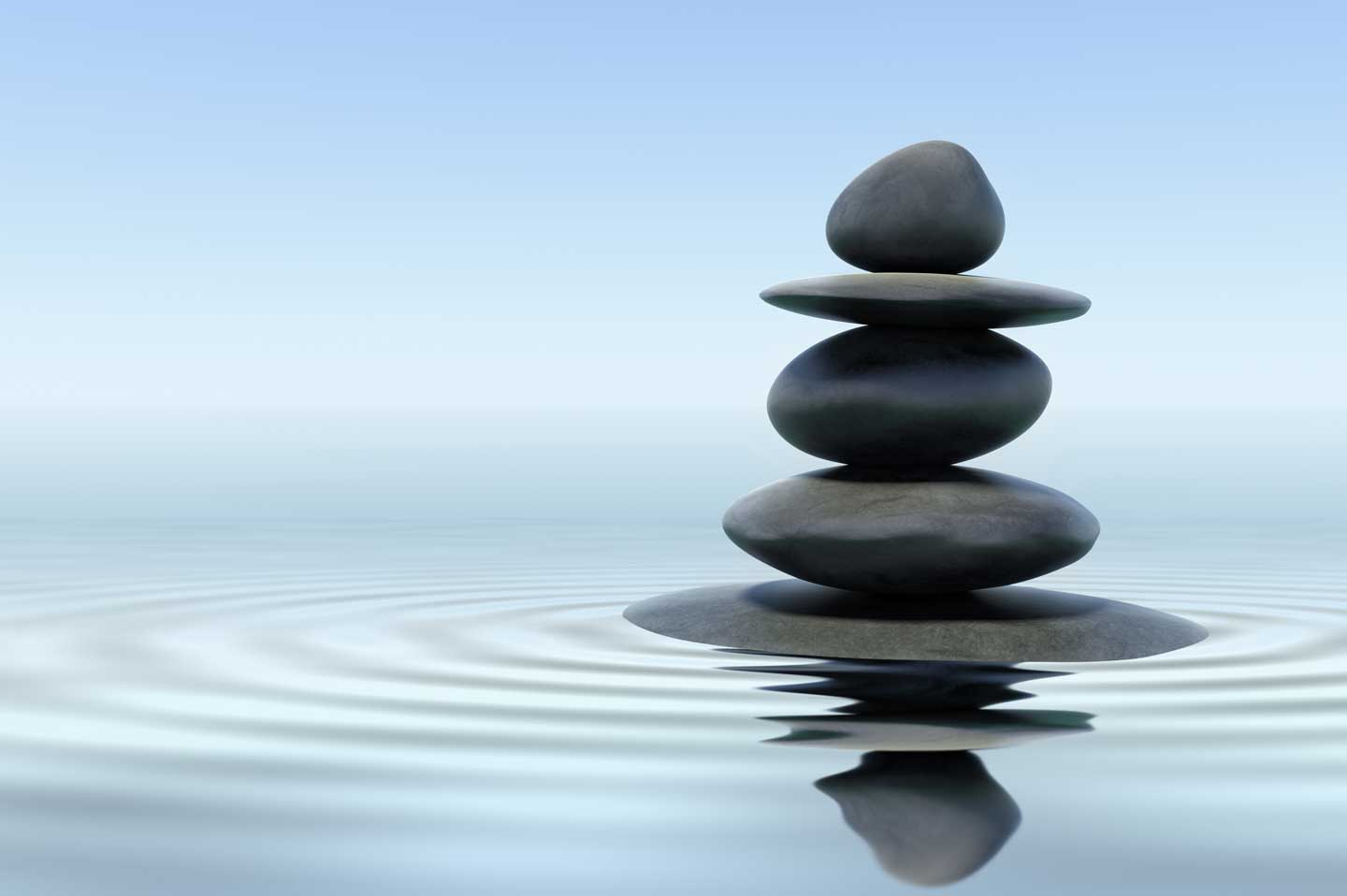 Water with stacked stones representing bowen therapy